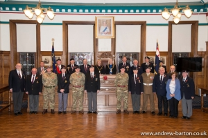 Visiting service personnel welcomed to the town hall