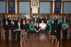The Mayor and Mayoress with St Ambulance members in the council chamber